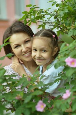 Portrait of little girl with mother in park Banco de Imagens