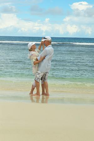 Portrait of cute elderly couple at tropical beach