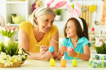 Senior grandmother and granddaughter with  Easter eggs Stock Photo