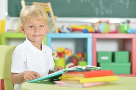 Portrait of cute little boy doing homework at home 版權商用圖片