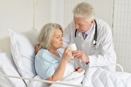 Close-up portrait of senior woman in hospital Stock Photo