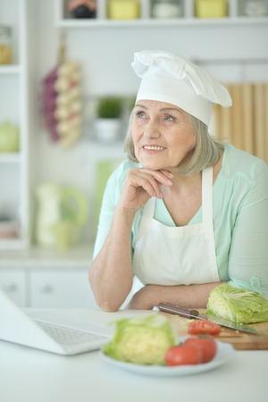 Portrait of senior woman chef portrait at kitchen Stock Photo
