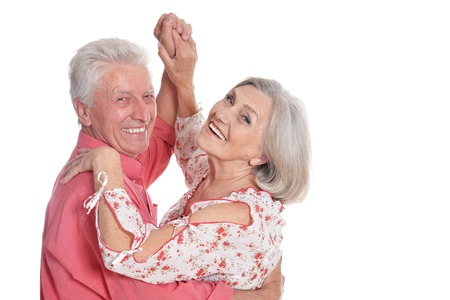 Happy senior couple dancing isolated on white background