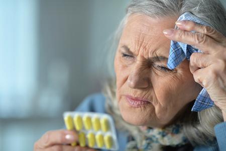 Beautiful Sad senior woman with headache