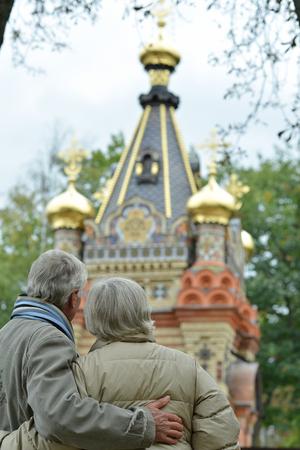 beautiful caucasian senior couple looking at church Imagens