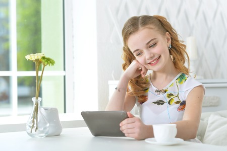Portrait of little girl looking at laptop