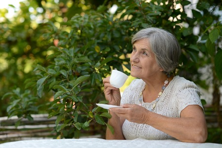 Elderly woman with coffee Imagens