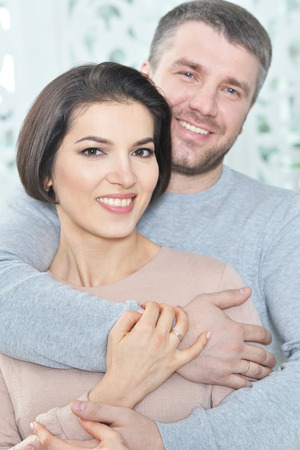 Portrait of happy beautiful young couple hugging
