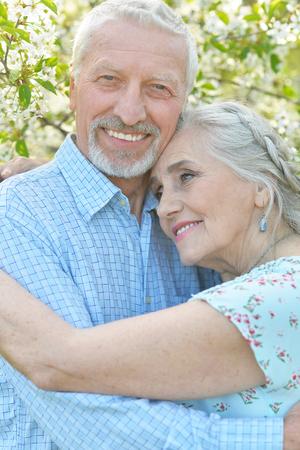 couple  hugging in  blooming garden 版權商用圖片