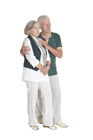 Full length portrait of senior couple embracing on white background Banco de Imagens