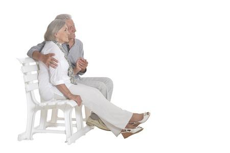 portrait of  senior couple sitting on bench