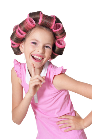 Portrait of emotional little pretty girl with hair curlers Stockfoto