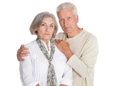 Portrait of sad senior couple on white background 写真素材