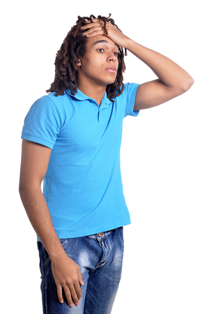 Young man with headache against white background