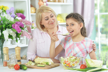 Portrait of mother and daughter cooking together