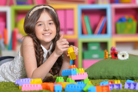 Portrait of girl playing with colorful blocks Stock Photo