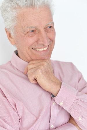 Close-up portrait of happy beautiful senior man posing at home Stock Photo