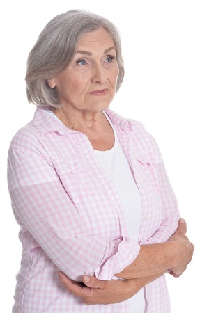 Portrait of beautiful senior woman posing isolated