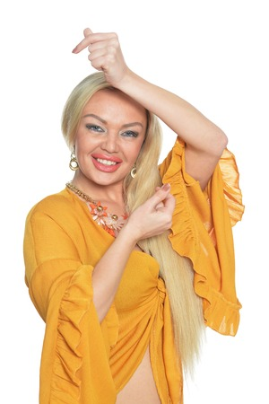 Beautiful woman in yellow blouse posing isolated on white background