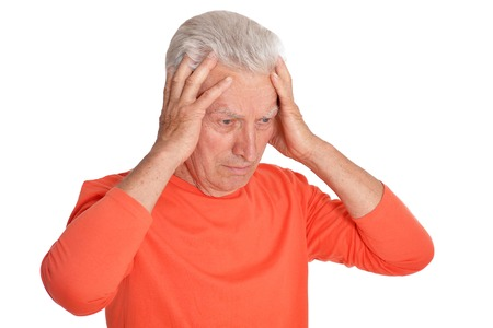 Portrait of sad senior man with headache on white background