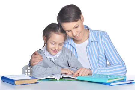 Mother with daughter reading books isolated on white background 스톡 콘텐츠