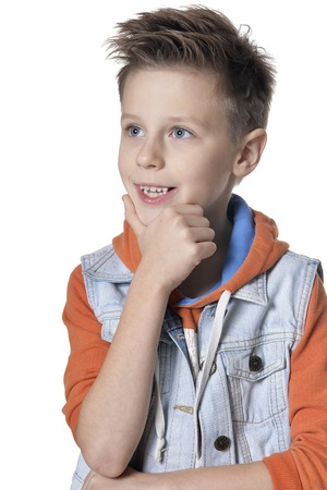 Portrait of handsome little boy posing against white background Banco de Imagens