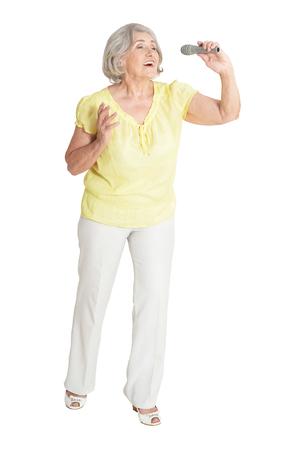 Portrait of senior woman singing isolated on white background