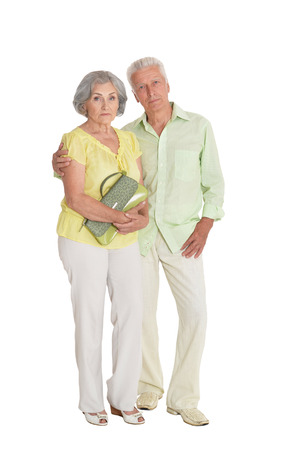 Portrait of happy senior couple posing on white background