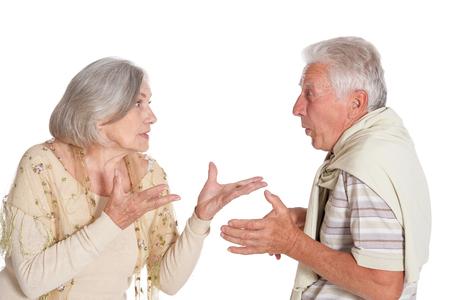 Portrait of arguing senior couple on white background Stockfoto