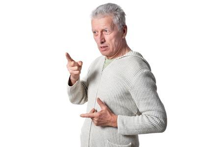 Portrait of senior man posing on white background Imagens