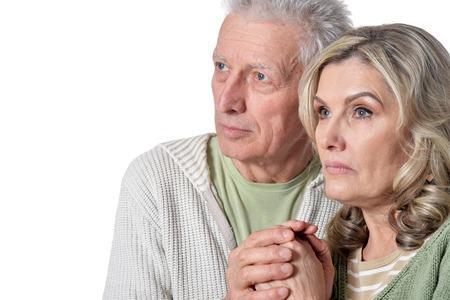 Portrait of calm senior couple on white background