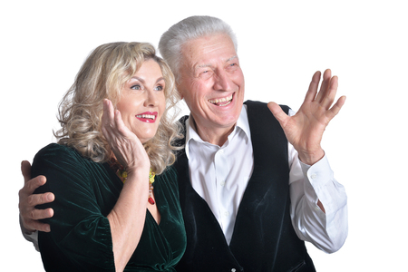 Portrait of happy surprised senior couple on white background Reklamní fotografie