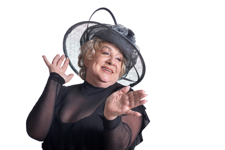 Senior woman in hat posing on white background
