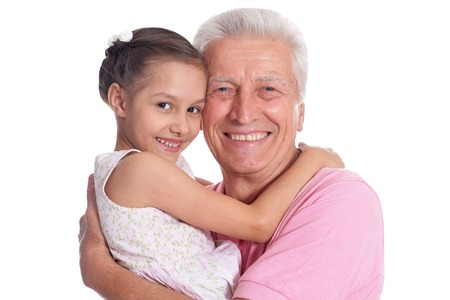 Happy elderly man with cute granddaughter isolated on white background