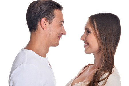 Happy beautiful young couple posing on white background