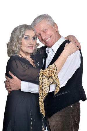 Happy senior couple hugging isolated on white background