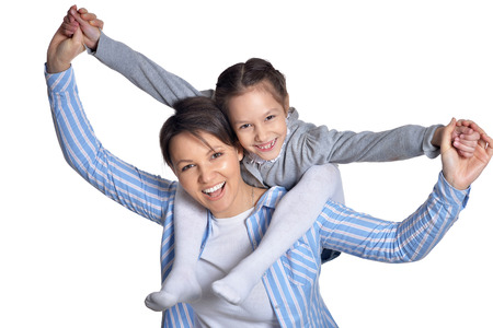 Happy mother with daughter having fun on white background