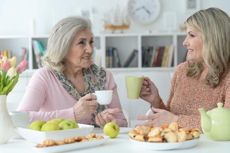 Portrait of two senior women drinking tea