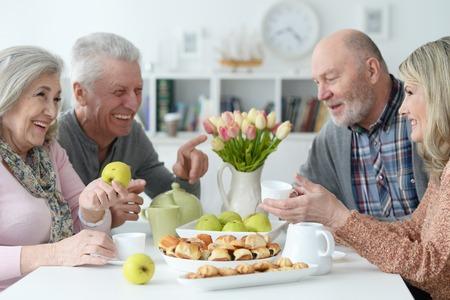 Portrait of two senior couples drinking tea 写真素材
