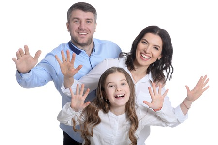 Happy family of three on white background