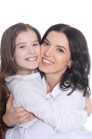 Portrait of happy mother and daughter posing on white background Stock Photo