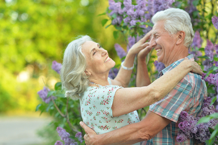 Beautiful senior couple dancing in the park