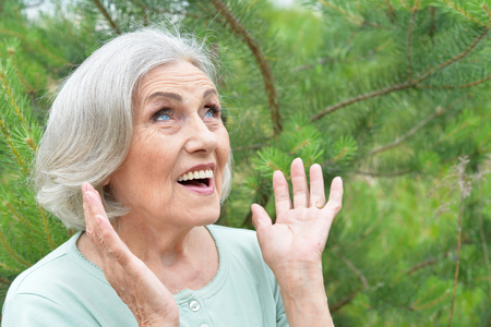 Portrait of happy surprised senior beautiful woman