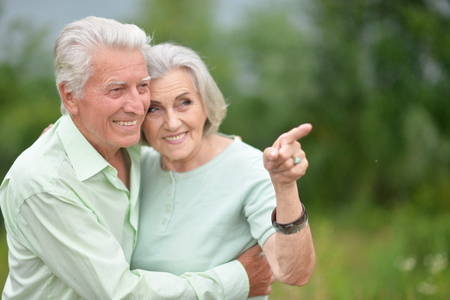 Portrait of beautiful senior couple hugging in the park