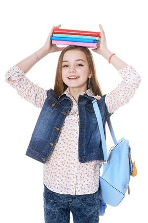 Happy schoolgirl posing with books on white background Stock Photo