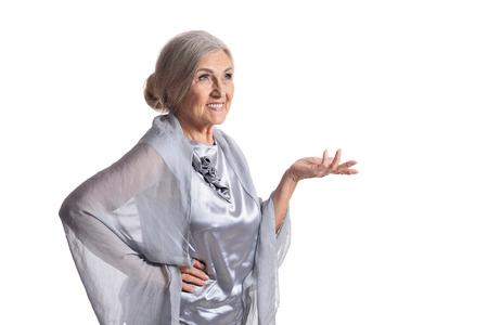Smiling beautiful senior woman posing on white background
