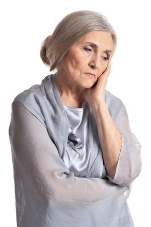 Portrait of sad senior woman posing isolated on white background Stock Photo