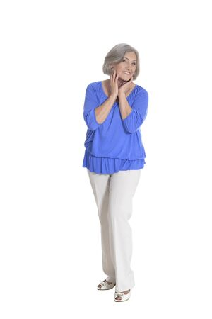 Full length, happy senior woman posing on white background 스톡 콘텐츠