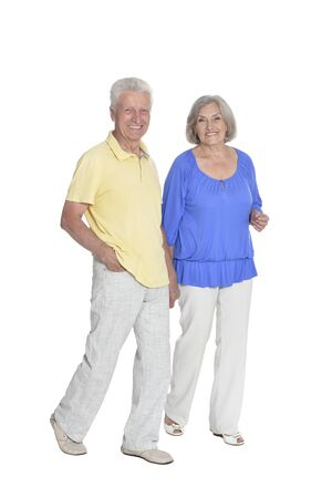 Full length portrait of senior couple holding hands isolated Stock Photo