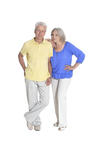 Senior couple hugging isolated on white background, full length